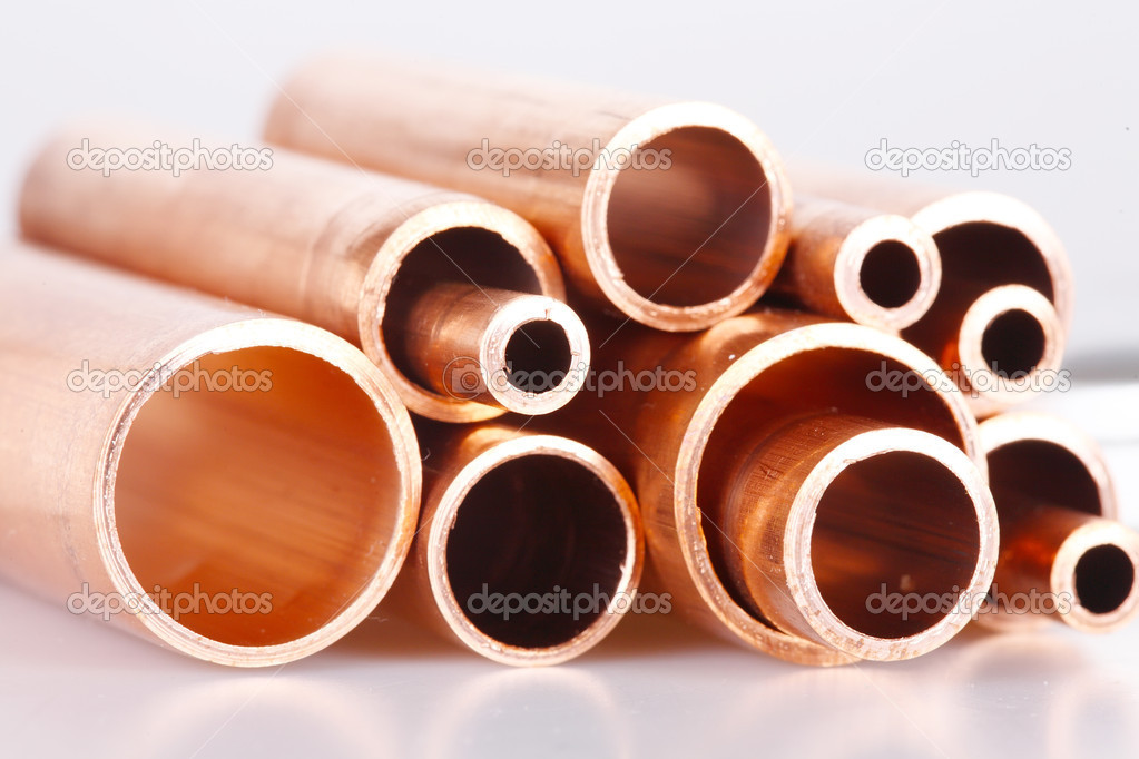 Set of copper pipes of different diameter lying in one heap — Stock Photo #4643928