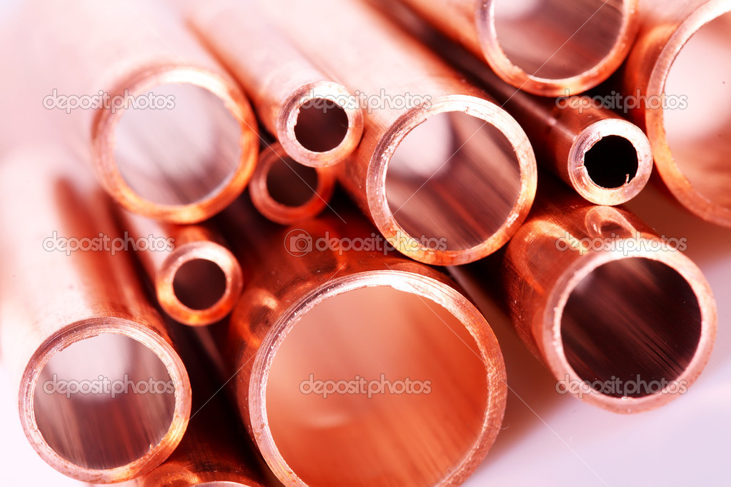 Set of copper pipes of different diameter lying in one heap  Zdjcie stockowe #4643941