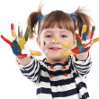 Four-year girl with hands soiled in a paint. — Stock Photo