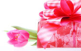 Tulip and gift box. — Stock Photo