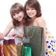 Two happy friends with purchases. It is isolated, a white background. — Stock Photo #5314590