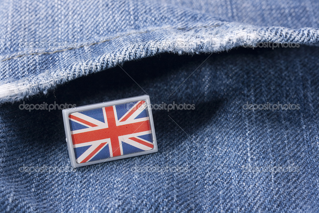 Flag of Great Britain against a pocket of dark blue jeans trousers.  Stock Photo #3939112