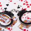 Handcuffs with things gaming — Stock Photo