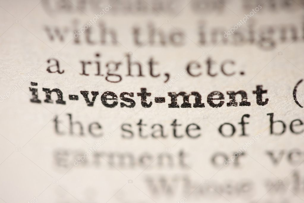 Word investment from the old dictionary, a close up. — Stock Photo #4327768
