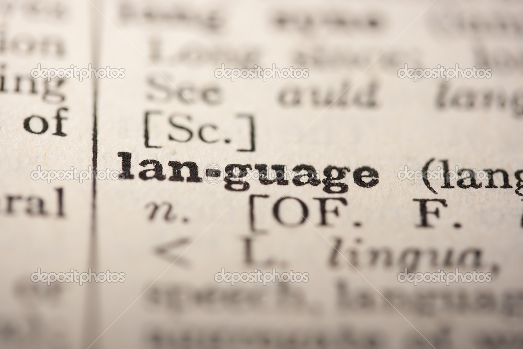 Word language from the old dictionary, a close up.  Stock Photo #4424781
