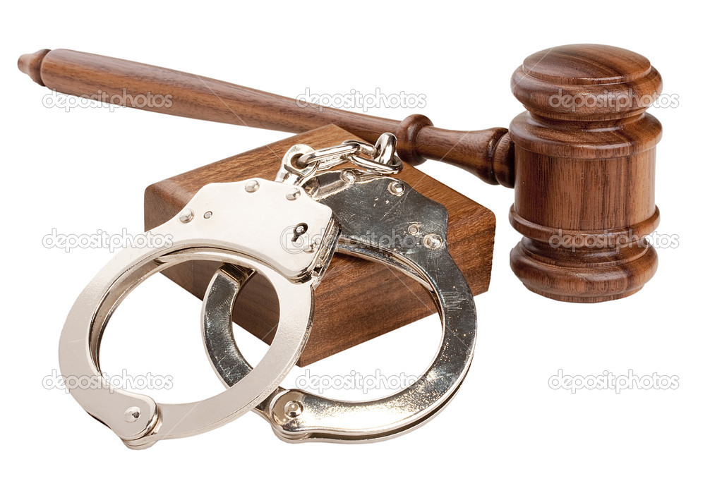 Wooden gavel and handcuffs isolated on a white background.  Stock Photo #4808205