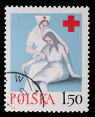 Poland - CIRCA 1964: A stamp - Caring for the elderly — Stock Photo