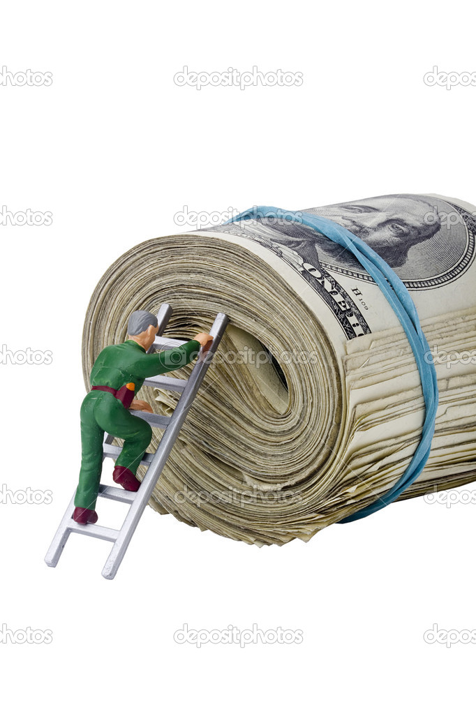 Miniature man climbing a roll of American money.  Stock Photo #5180391