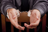 Arrested in handcuffs — Stock Photo