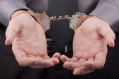 Arrest handcuffs — Stock Photo