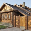 Stock Photo: Beautiful wooden house with carved front