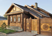 Beautiful wooden house with carved front — Stock Photo