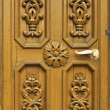 Stock Photo: Carved wooden door