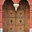 Old wooden door with carved ornament — Stock Photo