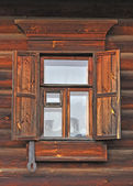 Window with wooden shutter — Stock Photo