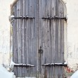 图库照片: Old wooden door in ancient russian monastery