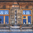 Two windows in old country house — Stock Photo