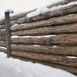 Massive rural wooden fence in winter time — Stock Photo