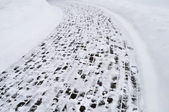 Snow covered pavement background — Stock Photo