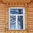New wooden window, decorated with carving - Stock Photo