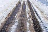 Asphalt road with snow — Stock Photo
