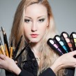 Blonde with cosmetics; — Stock Photo