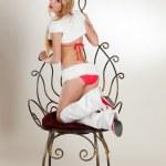 Girl posing on chair — Stock Photo