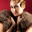 Portrait of elegant woman with fur — Stock Photo