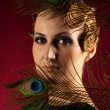 Vertical portrait of woman with feather — Stock Photo