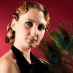 Portrait of elegant woman holding feather — Stock Photo
