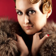 Portrait of elegant woman holding fur - Stock Photo