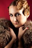 Portrait of elegant woman holding fur — Stock Photo