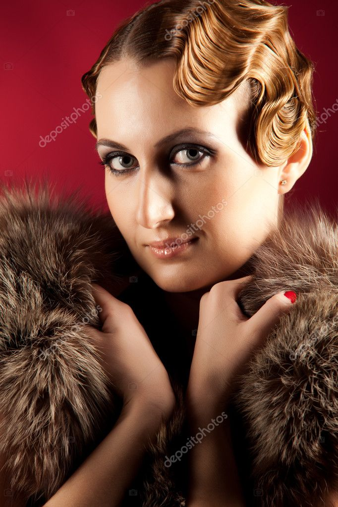 Portrait of elegant woman holding fur, close up shot — Stock Photo #4917101