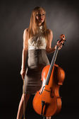Smiling girl with cello — Stock Photo