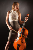 Elegant girl playing on bass-viol — Stock Photo