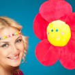 Smiling woman and flower — Stock Photo