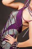 Close up shot of violet dress with pearls — Stok fotoğraf