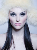 Portrait of attractive girl with furry hat — Stock Photo