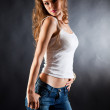 Posing girl in white t-shirt and jeans — Stock Photo