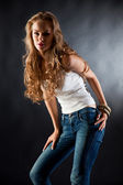 Young girl in white t-shirt and jeans — Stock Photo
