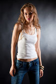 Sexy girl in white t-shirt and jeans — Stock Photo