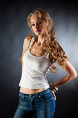 Girl in white t-shirt and jeans — Stock Photo