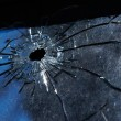 A bullet hole is in glass — Stock Photo
