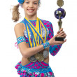 Beautiful young girl gymnast with a cup in hands — Stock Photo