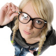 Pretty young woman with glasses looks like as nerdy girl, humor - Stock Photo