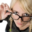 Pretty young woman with glasses looks like as nerdy girl, humor — Foto de Stock