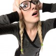 Pretty young woman with glasses looks like as nerdy girl, humor — Stock Photo