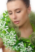 Pretty naked woman in flowers chaplet — Stock Photo
