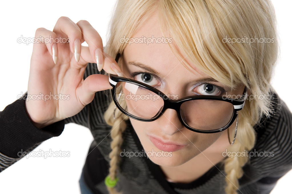 Smart young blond woman with funny glasses and plait looks like nerdy girl. Pose and looking at camera, humor style on white background. — Stock Photo #5216692