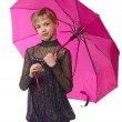 Pretty girl with pink umbrella. Isolated over white - Stock Photo